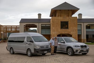 Your exclusive tour hosts, Hamish & Diane with their luxury tour vehicles at Craggy Range, Hawke's Bay NZ